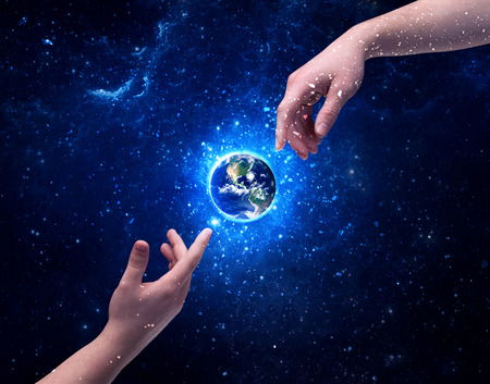 two generation family: Male god hands about to touch the earth globe in the galaxy with bright shining stars and blue light illustration concept. Elements of this image furnished by NASA.