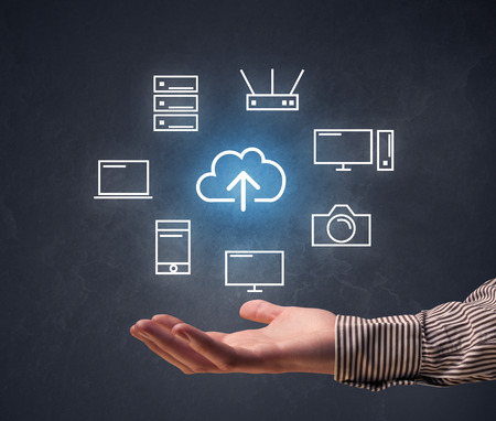 hovering: Cloud and computing related icons hovering over young hand