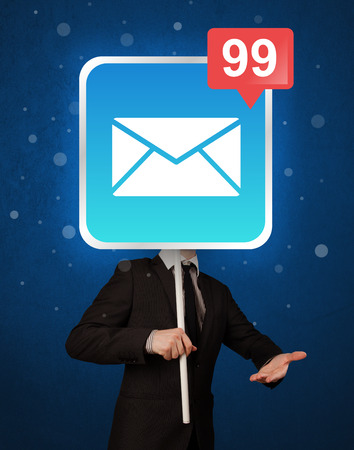 unread: Smart businessman holding square sign with mail icon Stock Photo
