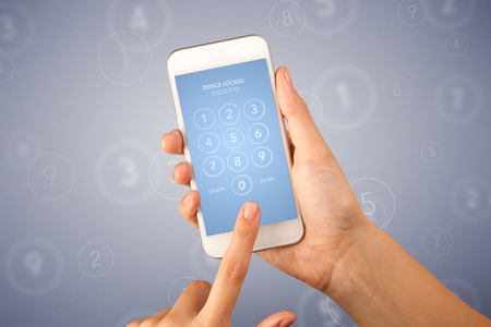 requiring: Female fingers touching smartphone with locked device requiring passcode