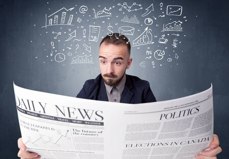 daily newspaper: Young smart businessman reading daily newspaper with business plan graphics above his head