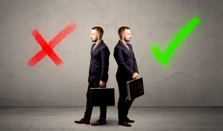 contradiction: Young conflicted businessman choosing between a right and a wrong direction