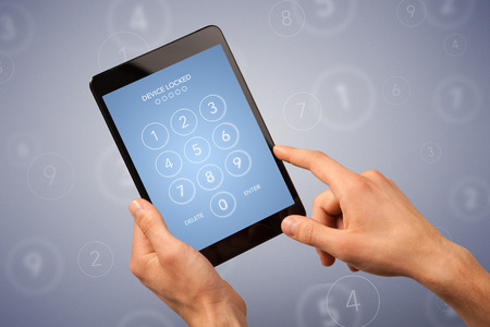 passcode: Female fingers touching tablet with locked device requiring passcode