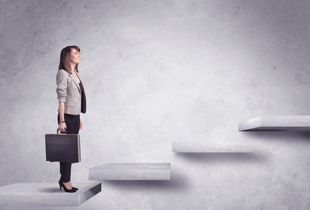 Business person stepping up a staircase photo