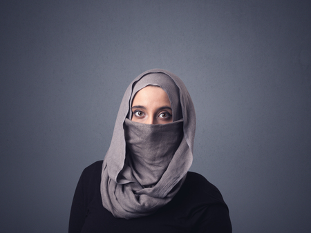 niqab: Young muslim woman wearing niqab