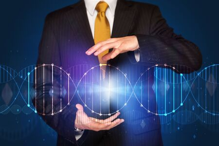 dna graph: Businessman with DNA concept in his hands
