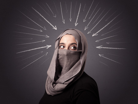 niqab: Young muslim woman wearing niqab with white arrows pointing to her head