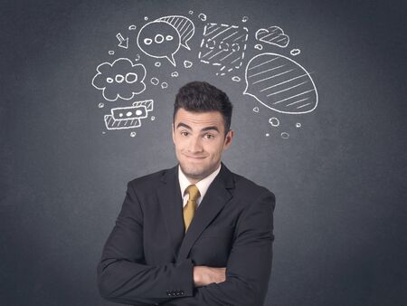 young businessman: Young businessman with drawn speech bubbles over his head