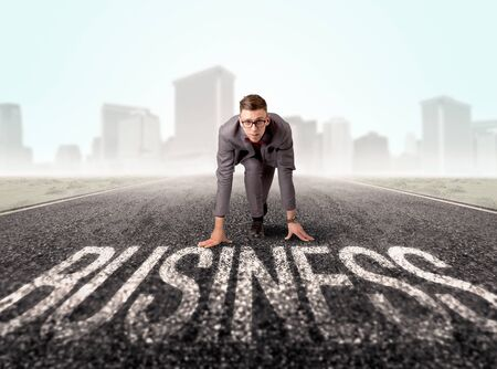 before: Young determined businessman kneeling before business text
