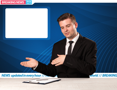 live stream tv: Television reporter telling breaking news at his studio desk with copy space concept