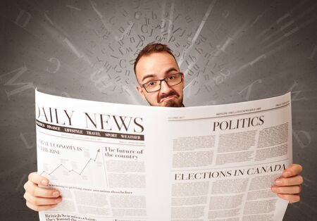 daily newspaper: Young smart businessman reading daily newspaper with alphabet letters above his head Stock Photo
