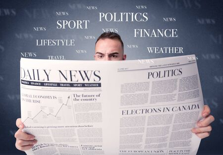 daily newspaper: Young smart businessman reading daily newspaper