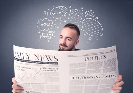 daily newspaper: Puzzled young businessman reading daily newspaper with speech bubbles above his head