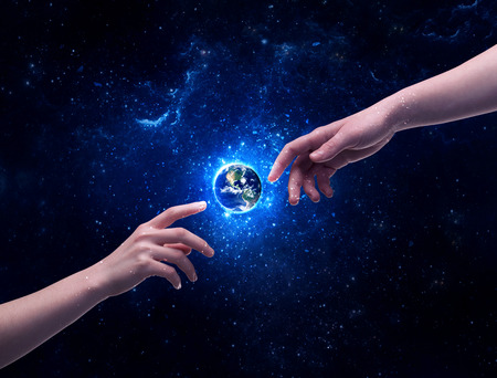 two generation family: Male god hands about to touch the earth globe in the galaxy with bright shining stars and blue light illustration concept. Stock Photo