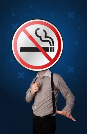 warned: Casual businessman holding round sign with no smoking graphic