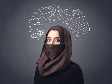 nationality: Young muslim woman wearing niqab with drawn speech bubbles above her head Stock Photo