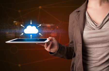 woman tablet: Casual young woman holding tablet with cloud concept Stock Photo