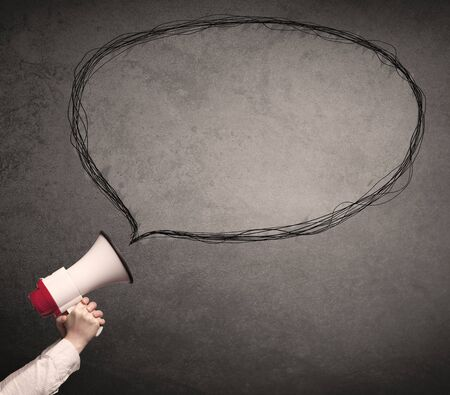 loudhailer: Caucasian business hand holding megaphone with drawn empty speech bubble