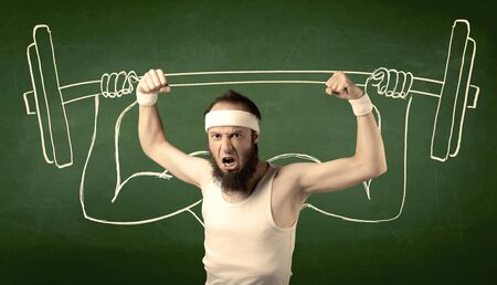 A young man with beard and glasses posing in front of green background, imagining how he would lift weight with big muscles, illustrated by white drawing concept. Stock Photo