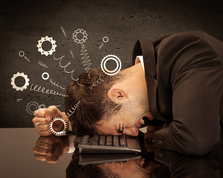 tired businessman: Falling apart illustration concept with cranks, cog wheels springing from a fed up and tired businessmans head resting on laptop keyboard Stock Photo
