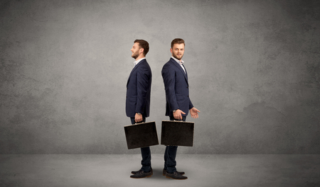 lost in thought: Young conflicted businessman choosing between two directions Stock Photo
