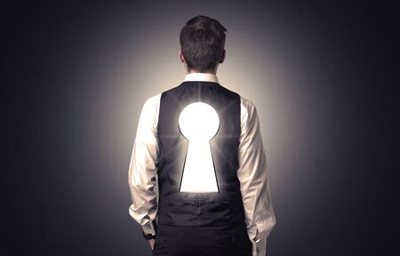 Businessman stays with black keyhole on his back.