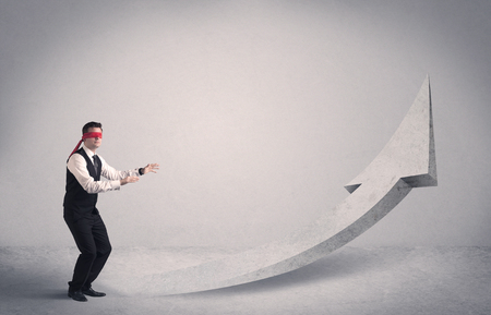 forced: A scared blindfolded businessman forced to face a problem concept with illustrated arrow pointng to the sky in empty space. Stock Photo