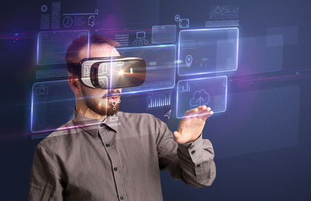 Amazed businessman with virtual reality charts and data in front of him. Stock Photo