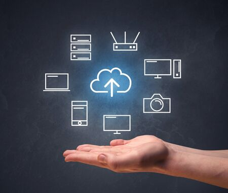 storage device: Cloud and computing related icons hovering over young hand