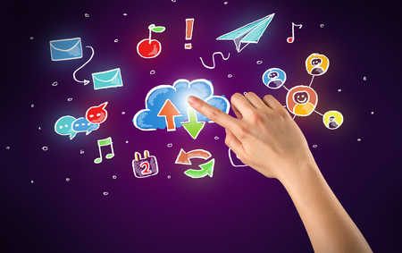 media gadget: Female hand toucing mixed media icons with purple background