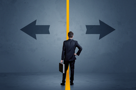 considerations: Business person choosing between two options separated by a yellow border arrow concept Stock Photo