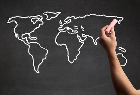 A teacher drawing the map of the world on a blackboard with a 76268351 a teacher drawing the map of the world on a blackboard with a chalk gumiabroncs Image collections