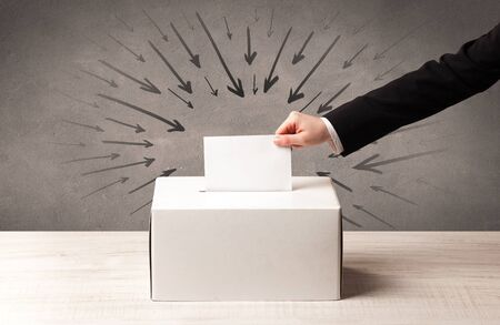 multidirectional: close up of a ballot box and casting vote on grungy background Stock Photo