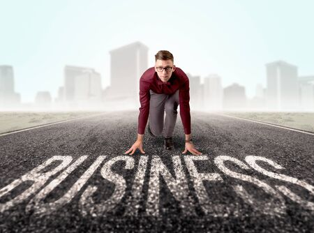 the enemy: Young determined businessman kneeling before business text