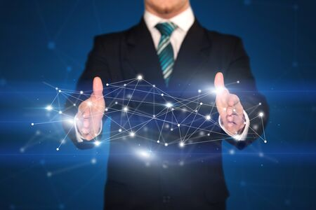 Businessman with network connection concept between his hands Stock Photo