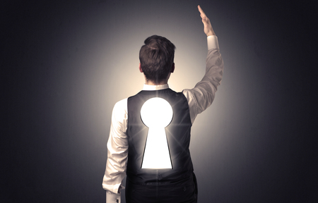 key hole: Young businessman standing and thinking with black keyhole on his back