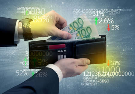 bribery: Businessman and takes out euro from wallet with stock exchange theme