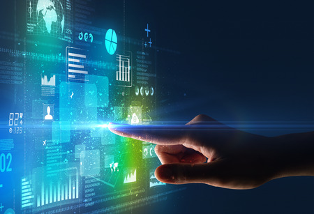Female finger touching a beam of light surrounded by blue and green data and charts Stock Photo