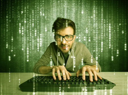 A talented hacker scanning online passwords database and hacking emails of users with numbers, codes, letters running in the background concept Stock Photo