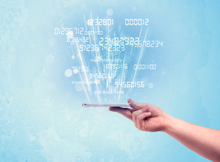 A white hand holding a tablet smartphone with digital numbers and information escaping the device illustration concept