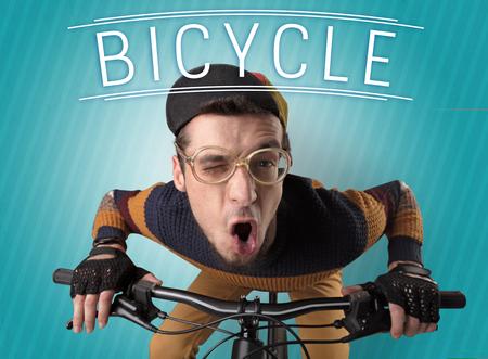 kooky: Kooky young guy on a bike with cyclist keywording and streaky background