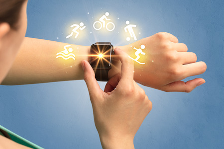 healthfulness: Female hand with smartwatch and sport concept.
