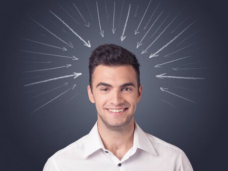 difficult decision: Young casual businessman with arrows pointing to his head