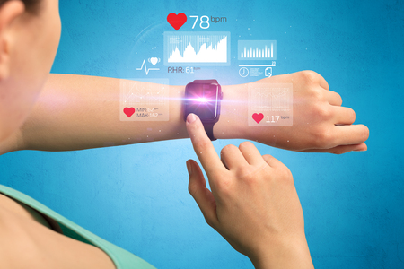 bpm: Female hand with smartwatch and health application icons nearby.