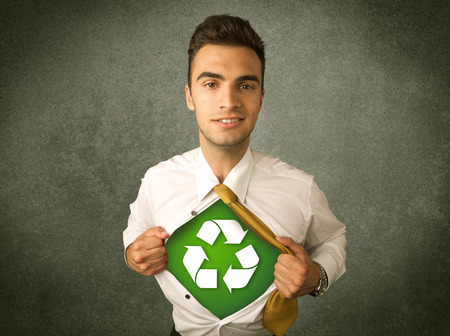 super man: Enviromentalist business man tearing off shirt with recycle sign on his chest concept on backround