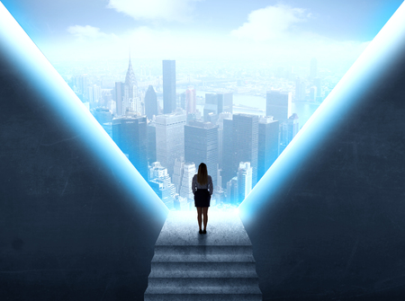 Businesswoman standing in the prison and looking at the cityscape photo