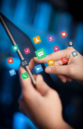 Female hands touching tablet with colorful applications Stock Photo