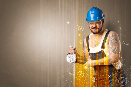 Manual worker with wrench symbols and tool. Stock Photo