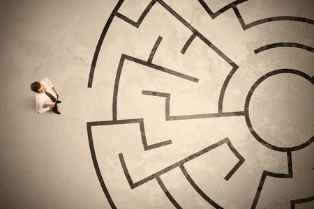 corridors: Lost business man looking for a way in circular labyrinth concept