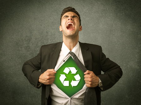 enviroment: Enviromentalist business man tearing off shirt with recycle sign on his chest concept on backround